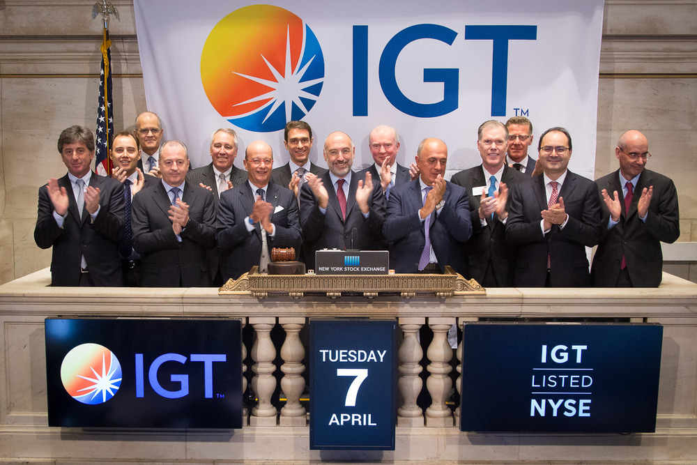 IGT executives applaud the ringing of the bell at the NYSE upon the launch of their new company and stock listing