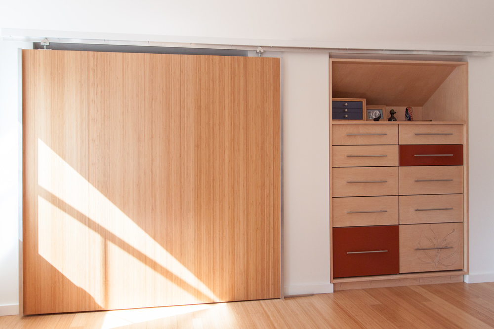 Bedroom Dressers and Sliding Closet Door. The sliding door was made from  the same bamboo