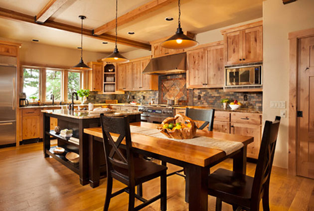 An open concept kitchen lets hosts mingle while they cook. Photo by Blackstone Edge, courtesy of Brock Design Group.