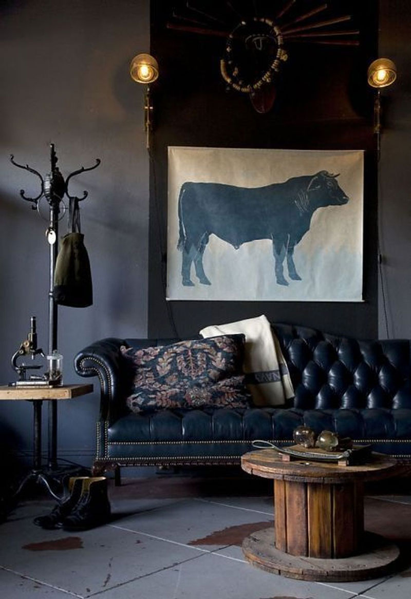 Grays and indigos with a few touches of warm wood tones create a moody, masculine feel in this industrial space.  Photo via Pinterest