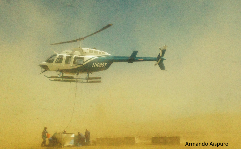 A helicopter and a hopper is used to deploy ant bait over hundred of infested acres on San Clemente and Santa Cruz Islands, California.