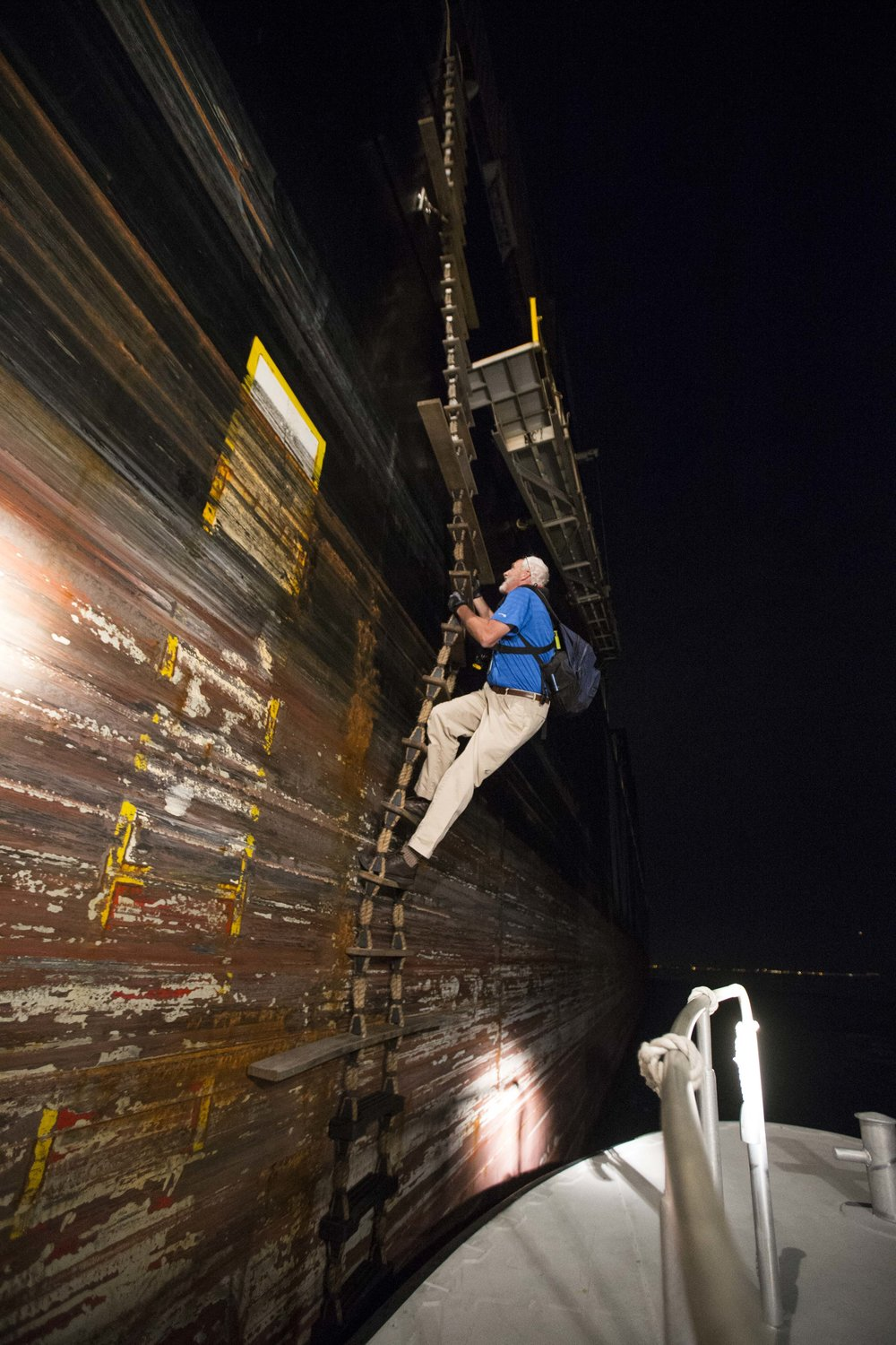 Boston Harbor Pilot climbs up the rope ladder of the cargo ship MSC Lorena as it continues to move at 15mph towards Boston Harbor on Aug. 16.