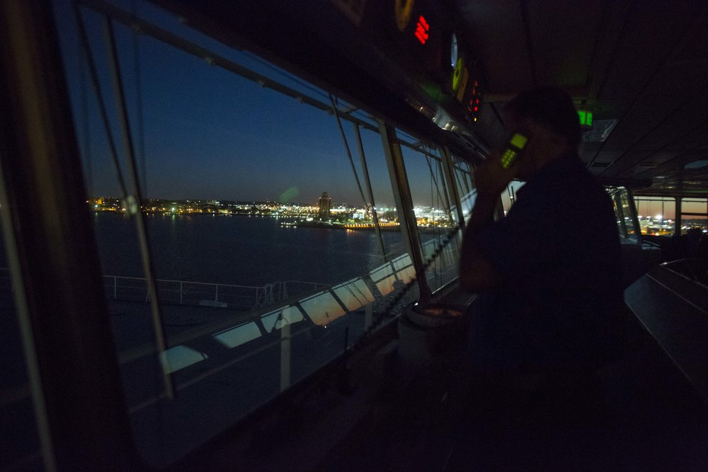 Boston Harbor Pilot Frank Morton makes a security radio call as the car carrying ship Heroic Leader enters the inner part of Boston Harbor under his guidance early on Aug. 23.