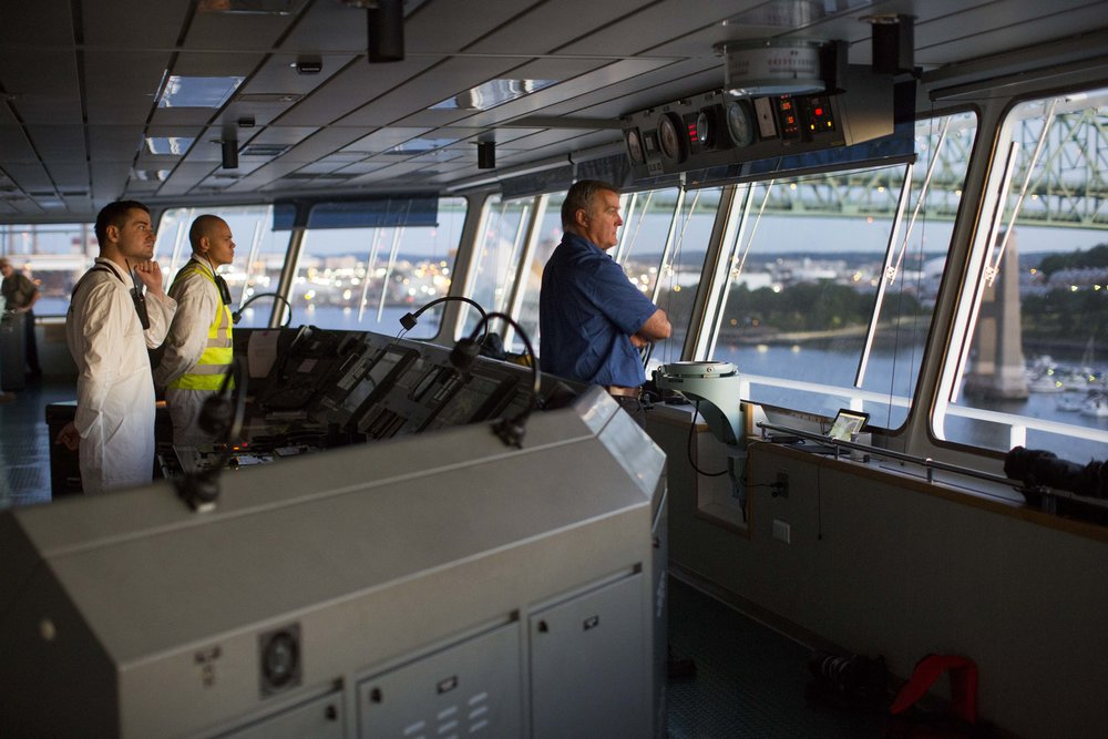 Boston Harbor Pilot Frank Morton watches from the wheelhouse of the car carrying ship Heroic Leader as it heads under the Tobin Bridge in Boston Harbor on Aug. 23.