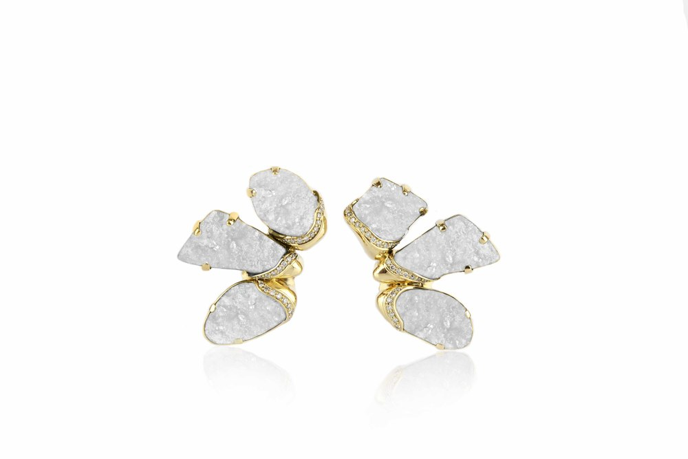 Kara's fan earrings in 18-karat gold set with white Bi-troydal Chalcedony Drusy.  Here's a version in white quartz .