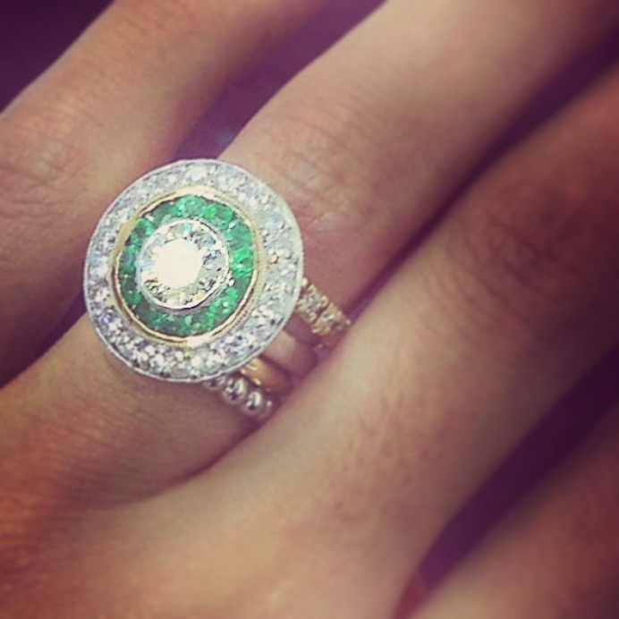 Bullseye! She wanted vintage-inspired with a modern edge. We went for emeralds and diamonds in a circular pattern.