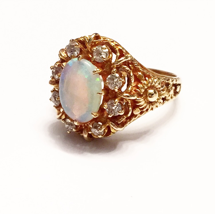 While this 14K original setting with a natural color change crystal opal is original, it was completely refurbished from a dire state and reset – and now looks better than brand new.