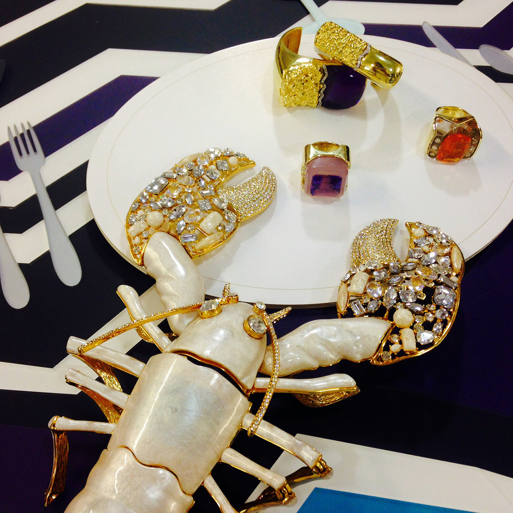 Follow Kara and  Lola the Lobster  (a bejeweled crustacean with a simulated mother of pearl body) on their Instagram adventures @kararossny.