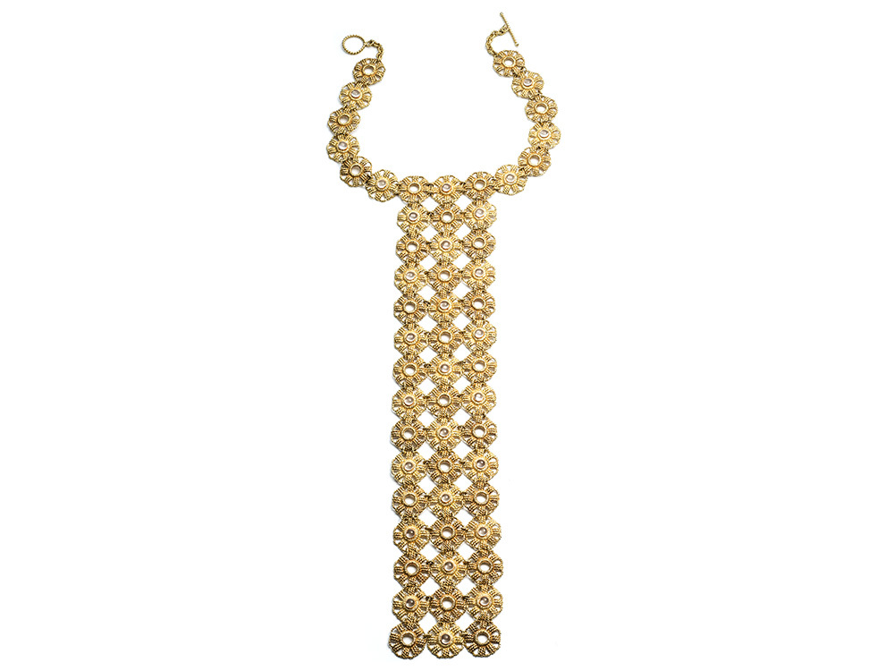 Flower tie necklace  in 18k gold with moonstone, $74,470.
