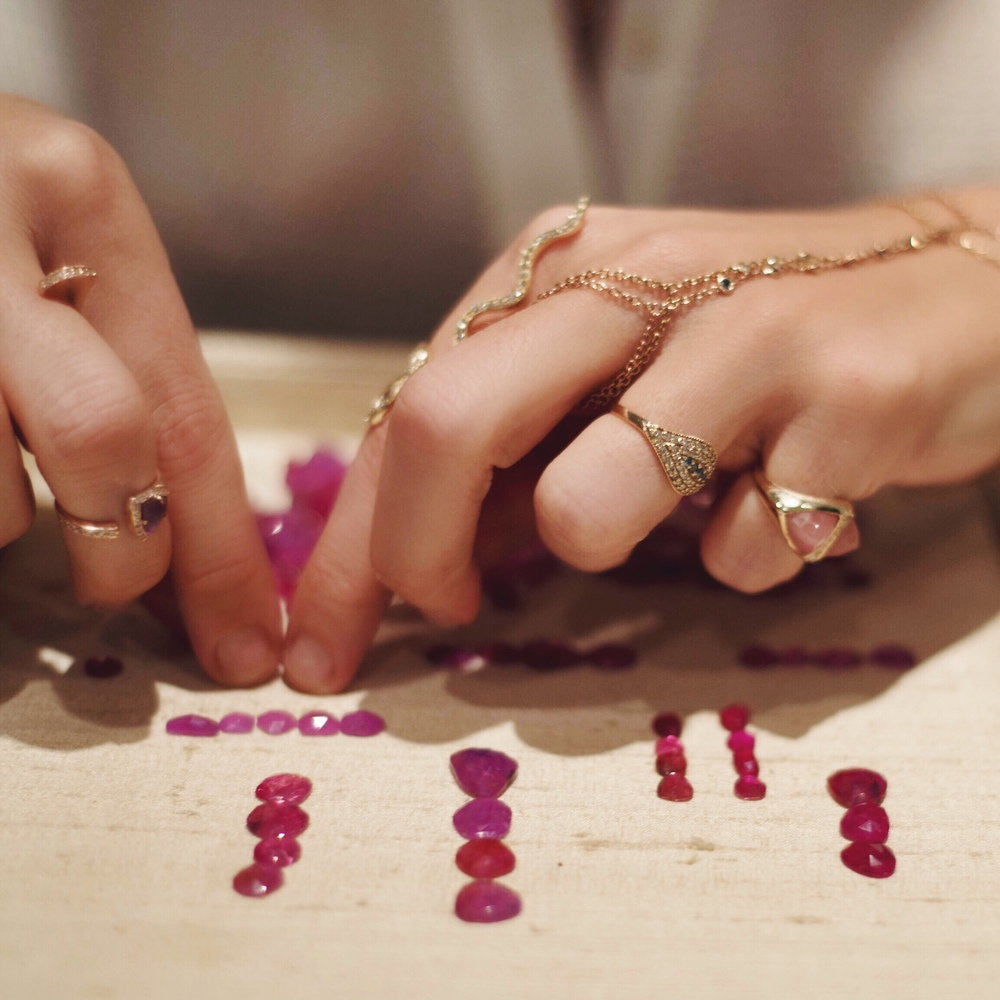 Jacquie's favorite pasttime: sorting through colorful gemstones to get inspired.