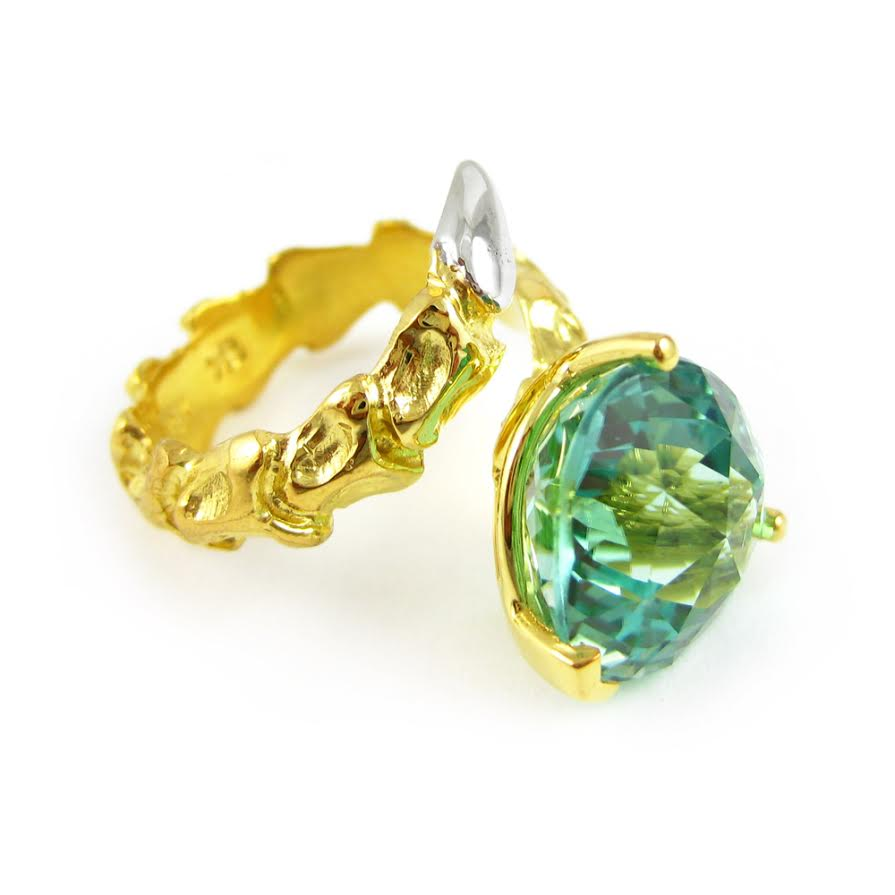 Small Vertebrae ring in 18k yellow gold with white gold tail and 8.79 carat neon green tourmaline, $37,825.