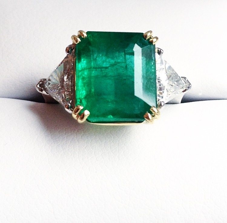We still dream about this ring. Custom FFR 5 carat Zambian emerald ring with 1.5 ctw E color diamond trillions set in 18-karat yellow gold and platinum. Sigh.