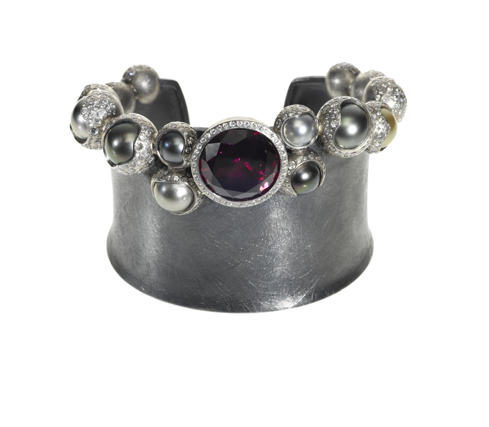 This pearl and garnet cuff in Palladium, silver, garnet (24.97 ctw), white brilliants (9.528 ctw), and Tahitian pearls, $158,400,  available at Todd Reed .