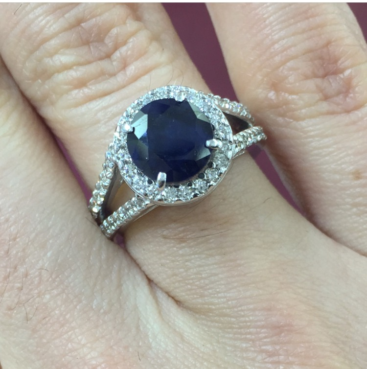 The old ring, completely refurbished, gained a sapphire (her son's birthstone) and is now a take on a Mother's ring.