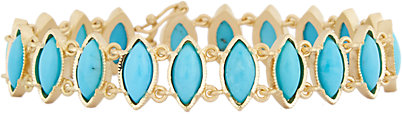Irene Neuwirth marquise turquoise bracelet in 18K yellow gold, $6,845, available at  Barneys.com