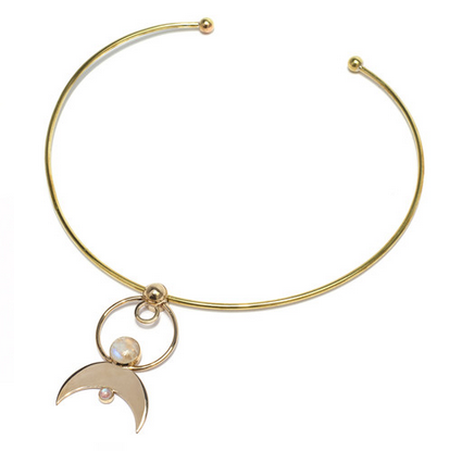 Pamela Love Cosmos necklace in brass with moonstone, $250,  available at Pamela Love .