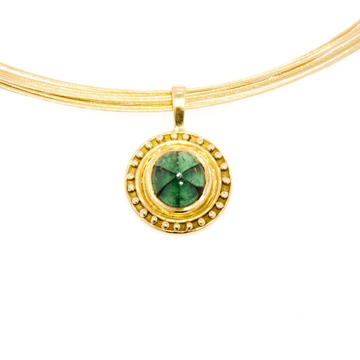 Jens Hansen  trapiche emerald pendant in 18-karat yellow gold, $3,299,  available at Jens Hansen .