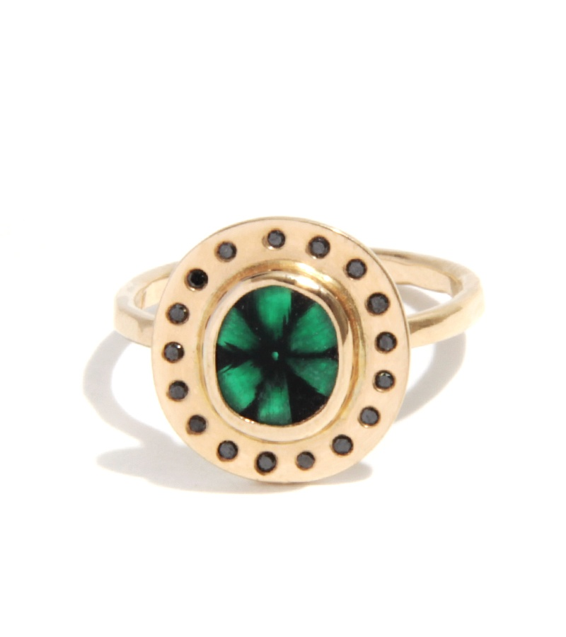 Melissa Joy Manning  trapiche emerald ring in recycled 18-karat yellow gold with black diamond halo $2,900,  available at Melissa Joy Manning .