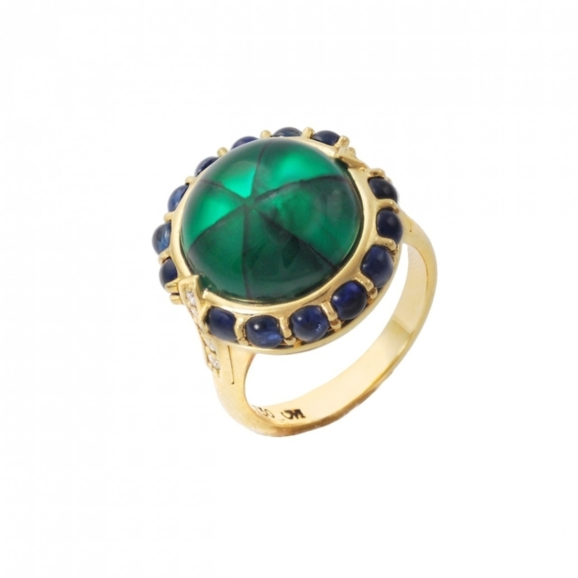 """Monica Rich Kosann  one-of-a-kind """"Secret"""" trapiche emerald ring in 18-karat yellow gold with sapphires, $49,000,  available by request at Monica Rich Kosann ."""