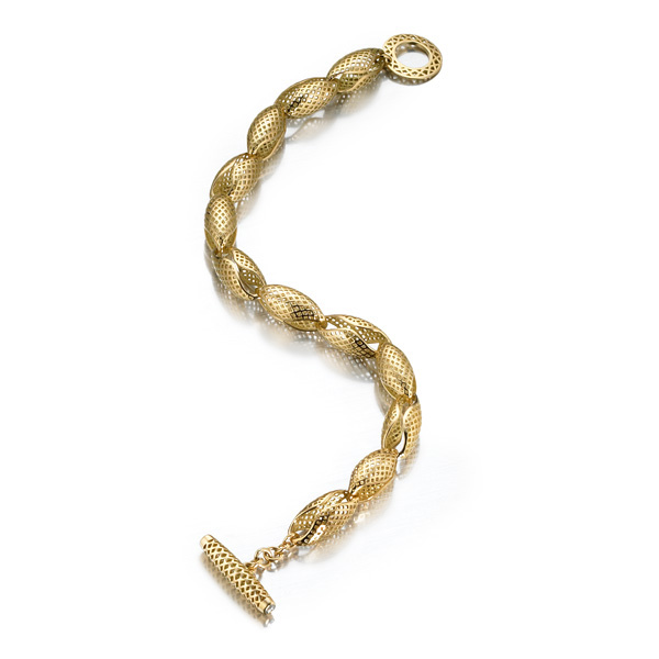 18k Yellow Gold crownwork conch shell bracelet with diamond set bale.