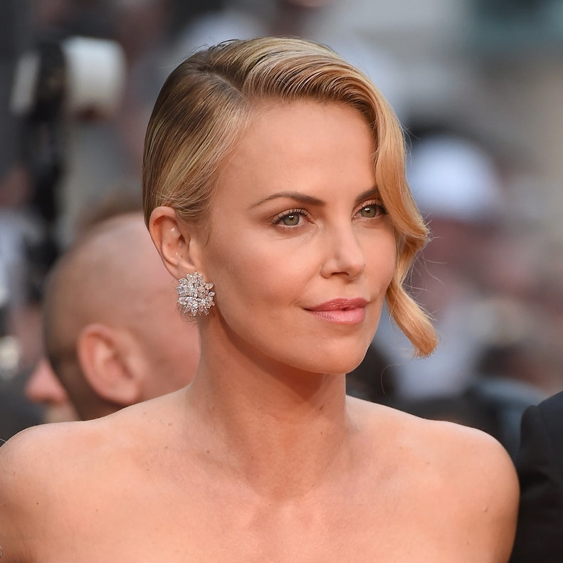 Chopard's amazing gold and diamond large button earrings on Charlize Theron at the 'Mad Max' premiere.