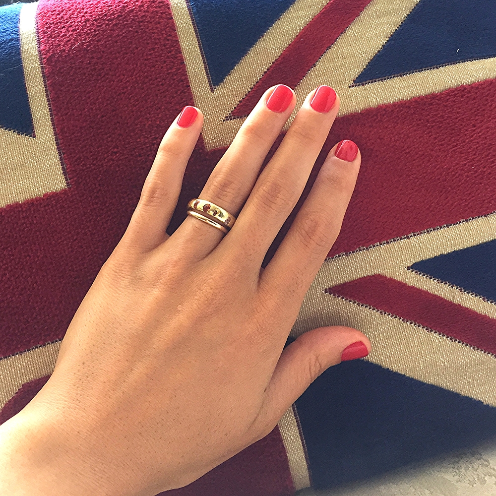 Signature multi sapphire band on Meaghan's hand for scale. And a Union jack pillow bc Polly's British.