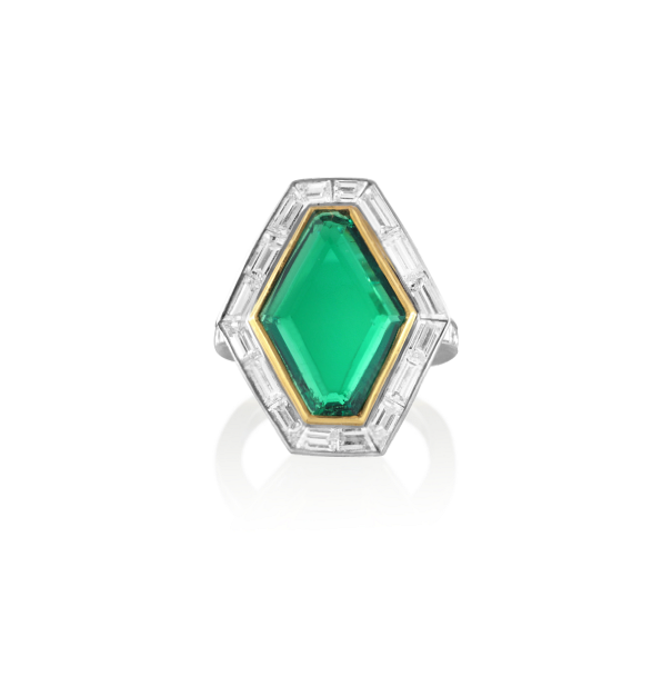 An Art Deco Fred Leighton 6ct deep green diamond-shaped emerald in an 18K yellow gold and platinum base with white baguette diamonds, $80,000  available at Stone & Strand .