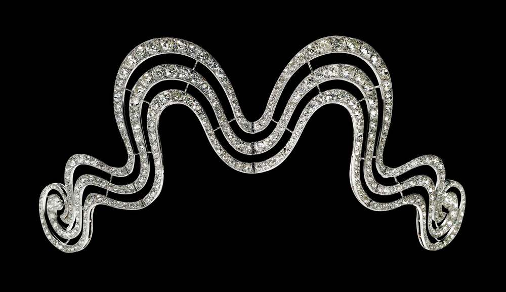 This swirly masterpiece is from Cartier  Paris, 1902, and contains old and rose-cut diamonds in a platinum millegrain setting.