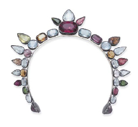 An unusual Art Decomulti-gem and silver tiara by Coco  Chanel  withcushion, circular and oval-cut aquamarine, tourmaline, amethyst and citrine accents, c.1925.