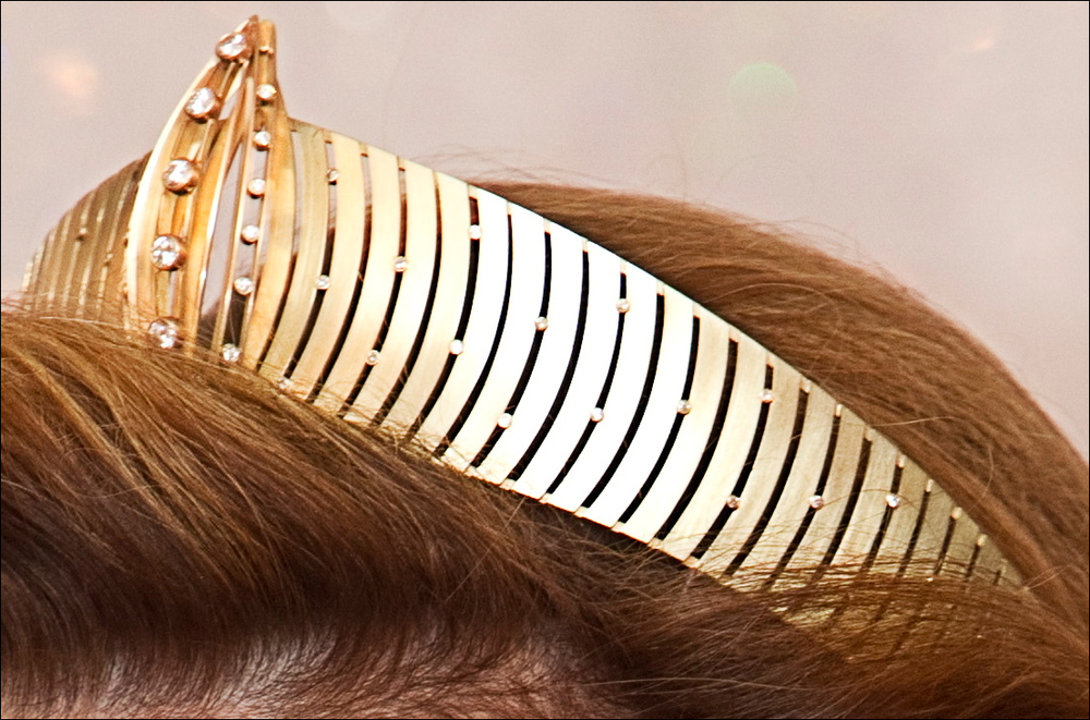 The gold and diamond tiara debuted by Queen Sonja of Norway in 1997. It's convertible and also has gemstone centerpieces. So sci-fi!