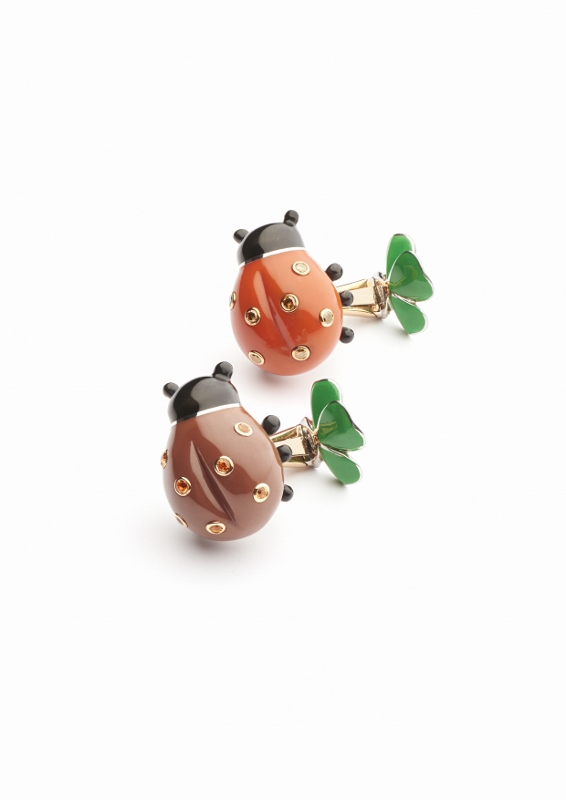 """Coccinelle"" cufflinks in gold and silver with brown diamonds, orange sapphires and diamonds."