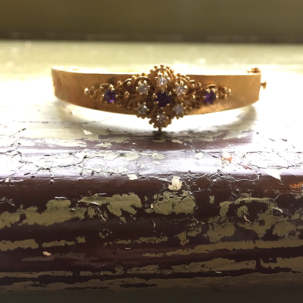 Amethyst and diamond bangle in 14K yellow gold. SOLD.