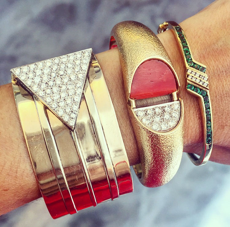 BRING BACK THE '80s! We'd like to note that the diamond triangle on the far left cuff opens to reveal a secret pill case.