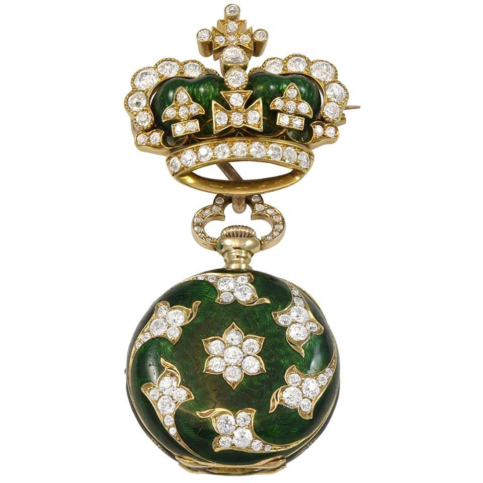 An early 20th Century Dreicer & Son  diamond and green enamel 18k yellow gold pocket watch brooch,  available at 1stdibs.com .