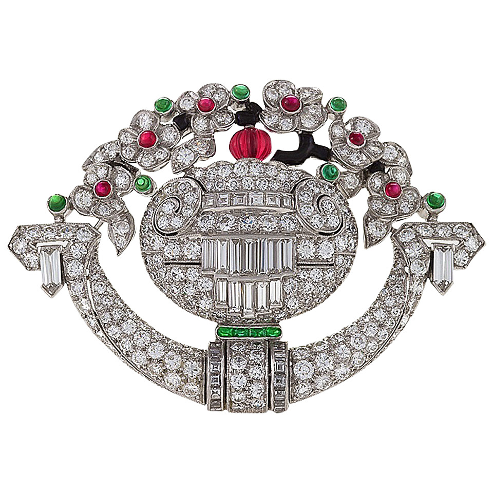 An American Art Deco platinum and enamel watch/brooch with diamonds, rubies and emeralds by  Tiffany & Co .,  available at 1stdibs.com .