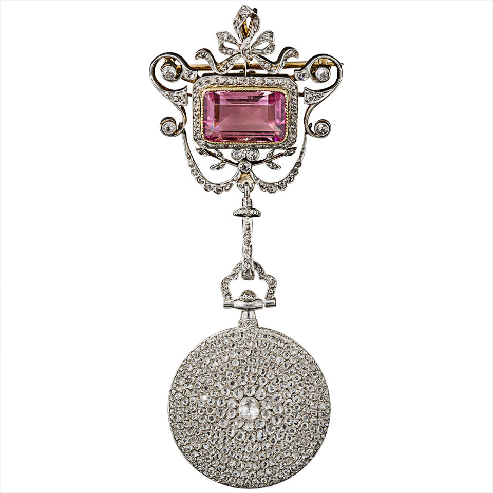 A 1920s Cartier Diamond Pendant Watch and Tourmaline Brooch, $27,500, available at 1stdibs.com .