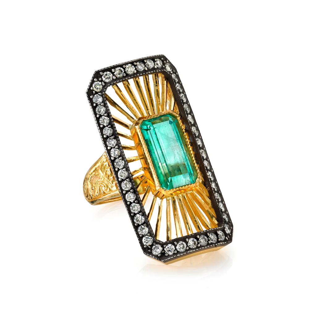 22K gold and silver Deco ring with an emerald center and diamonds, $14,560.