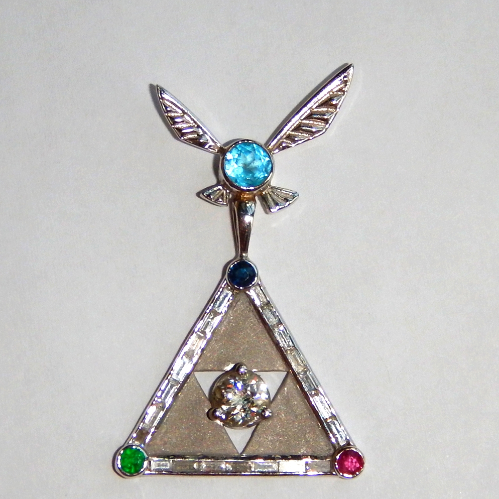 This was a re-vamp of a heirloom old mine cut diamond into a Zelda pendant. Just read the story  here.