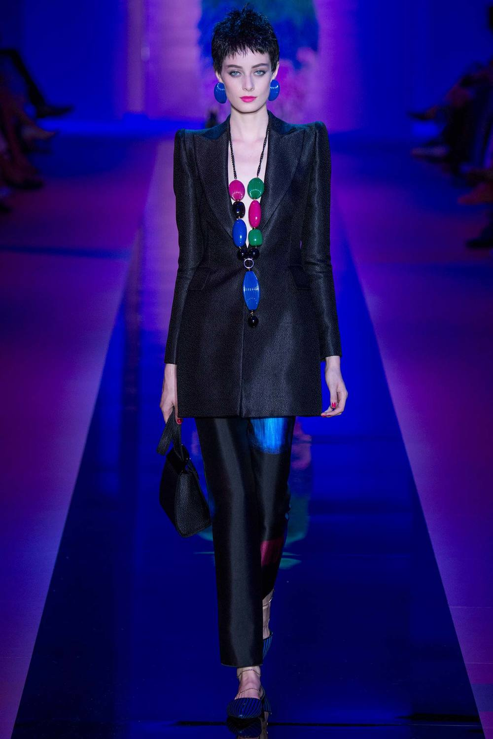 1980s realness from  Armani Privé , including massive earrings and a beaded necklace.