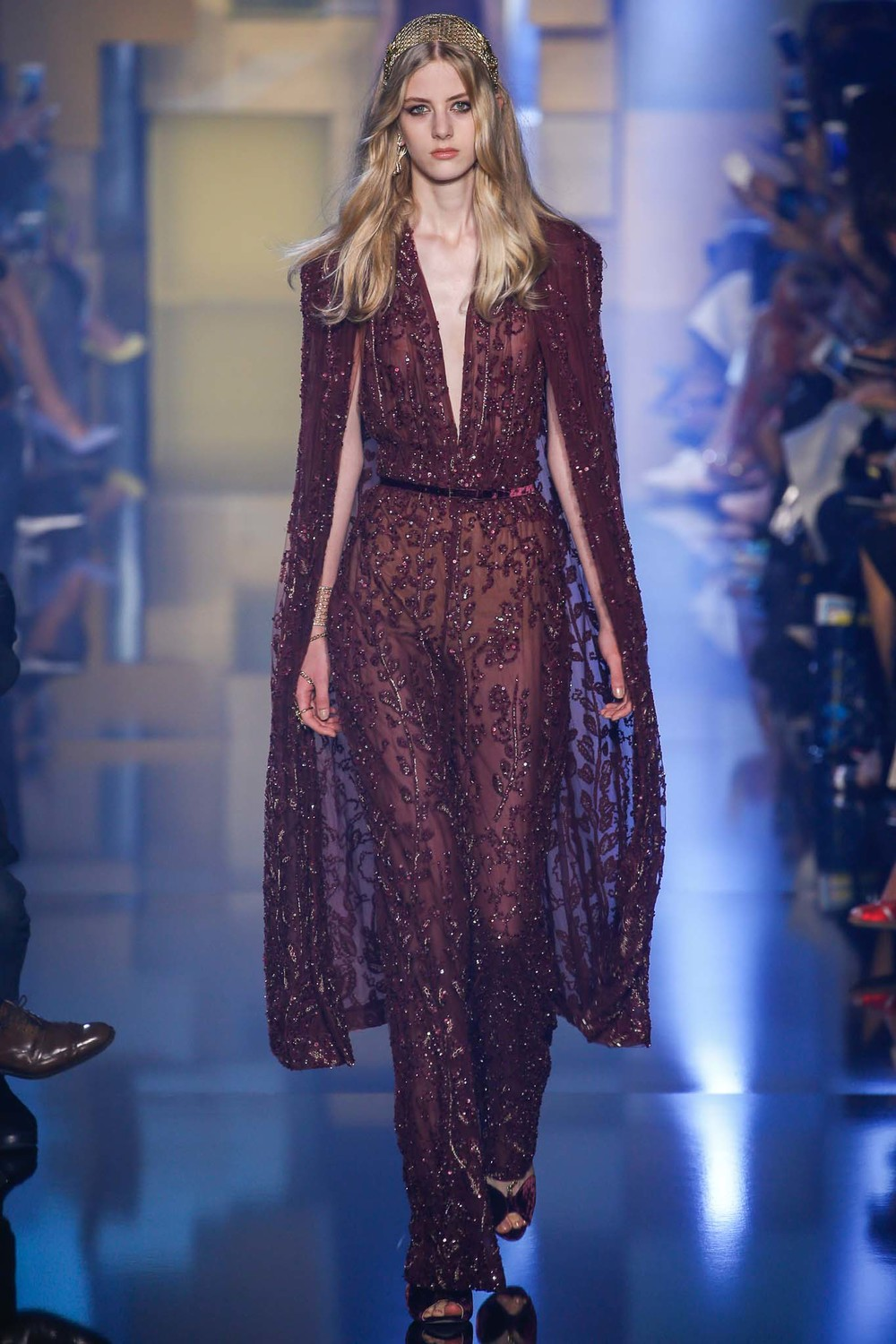 Elie Saab  made this beaded jumpsuit with a cape and added a tiara, earrings and a bracelet. HELLO!