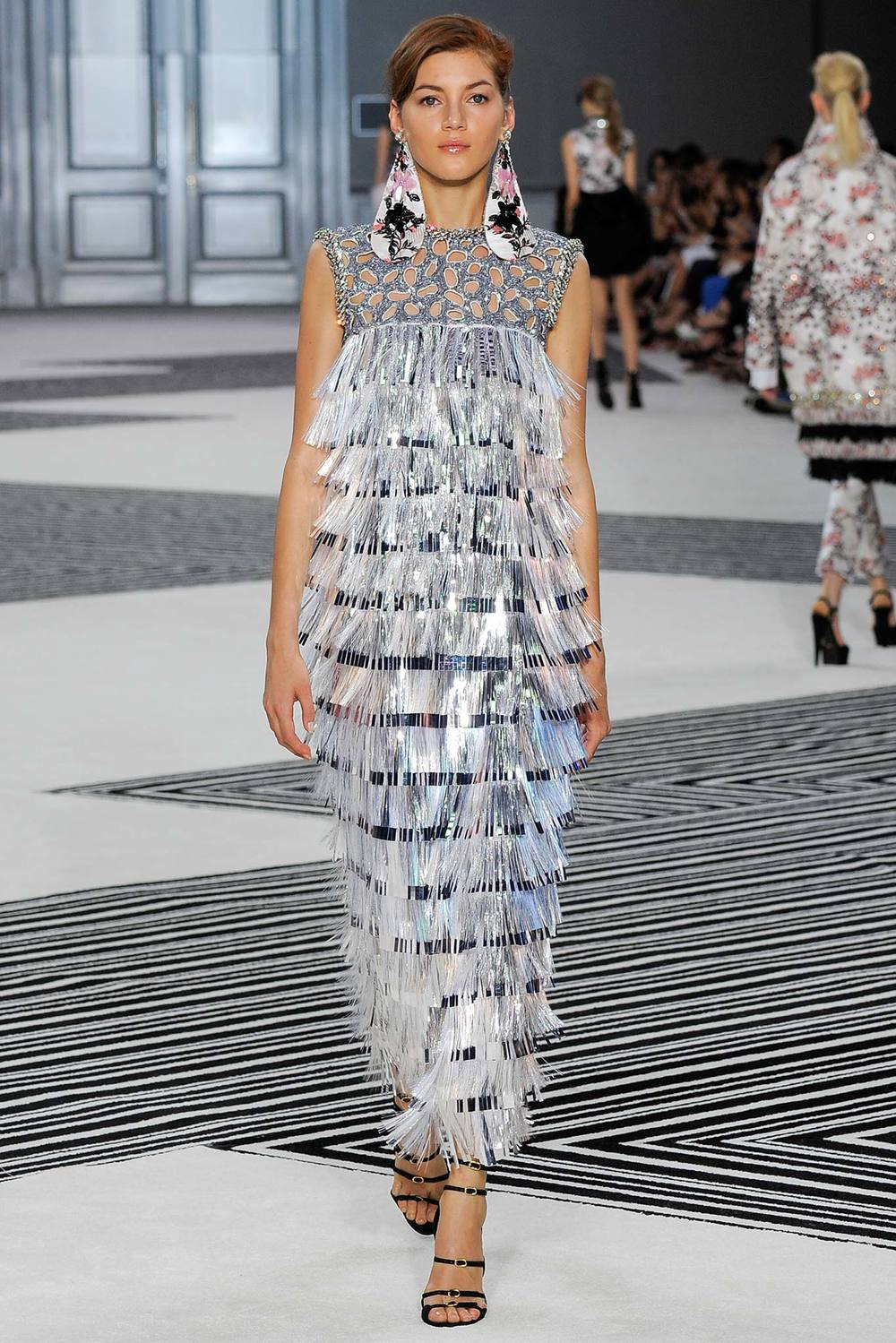 Giambattista Valli  created massive fabric earrings adorned with beads. AND THAT FRINGE DRESS YES.