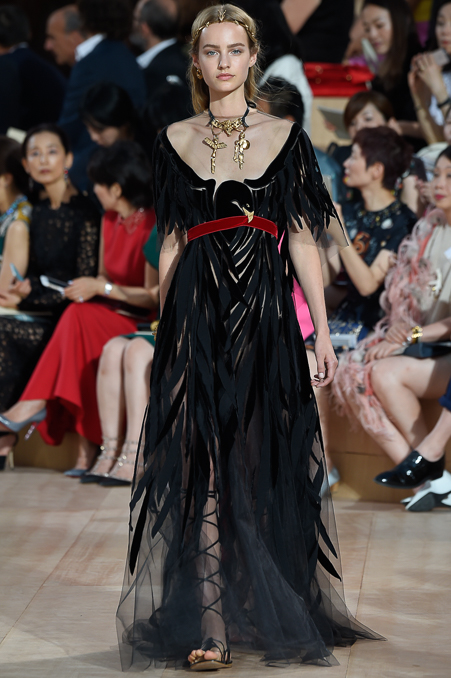 All hail sheerness and Roman sandals at  Valentino , where huge gold necklaces were the thing.