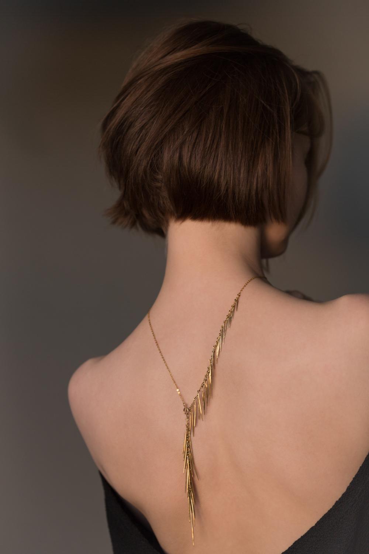 Gold fringe necklace with polished gold sticks, $9,800.