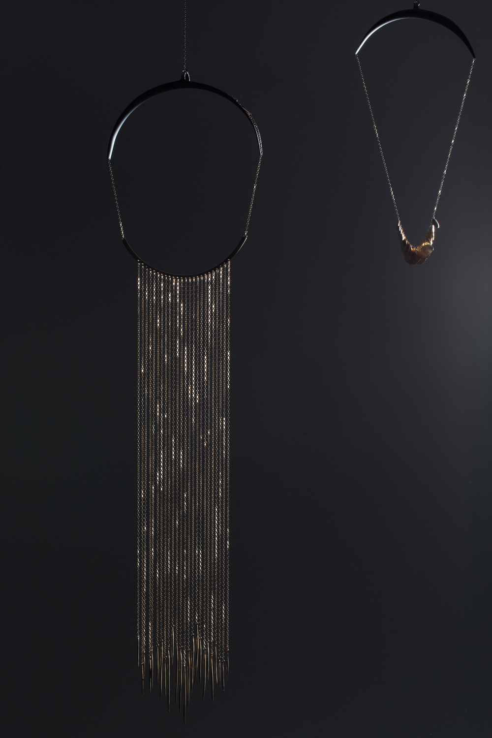 Gold Tuxedo necklace, left, $7,900; Shady Side gold necklace with polished gold fungus, right, $4,900.