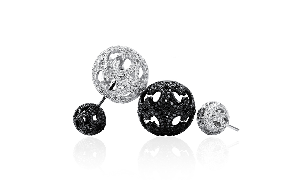 "Also brand new from ""Entwined with You"" – black and white diamond double ball earrings."