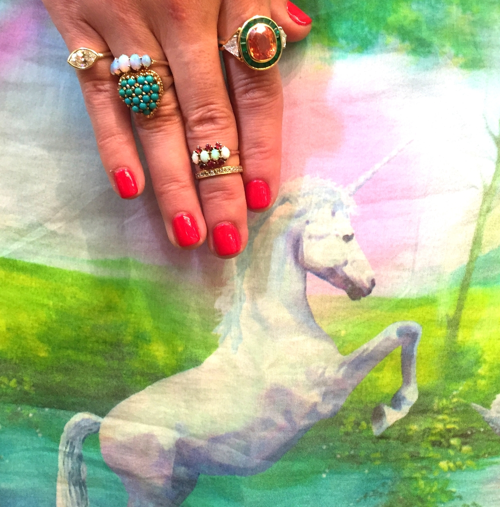 See? Unicorns do exist. In the form of a vintage padparadshaand emerald ring by Cartier.