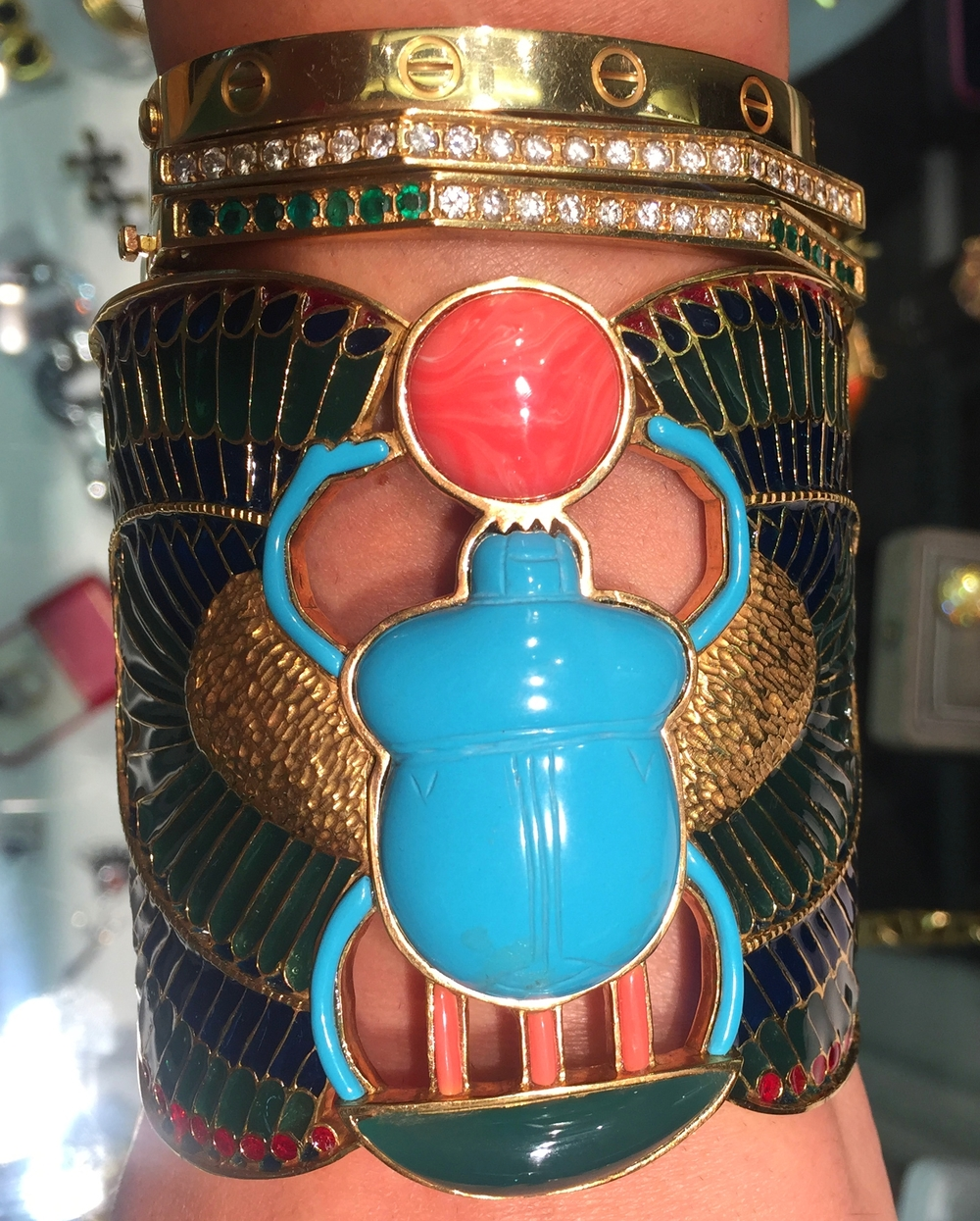 Walk like an Egyptian. An Egyptian covered in turquoise, plique-a-jour enamel, and gold scarabs.