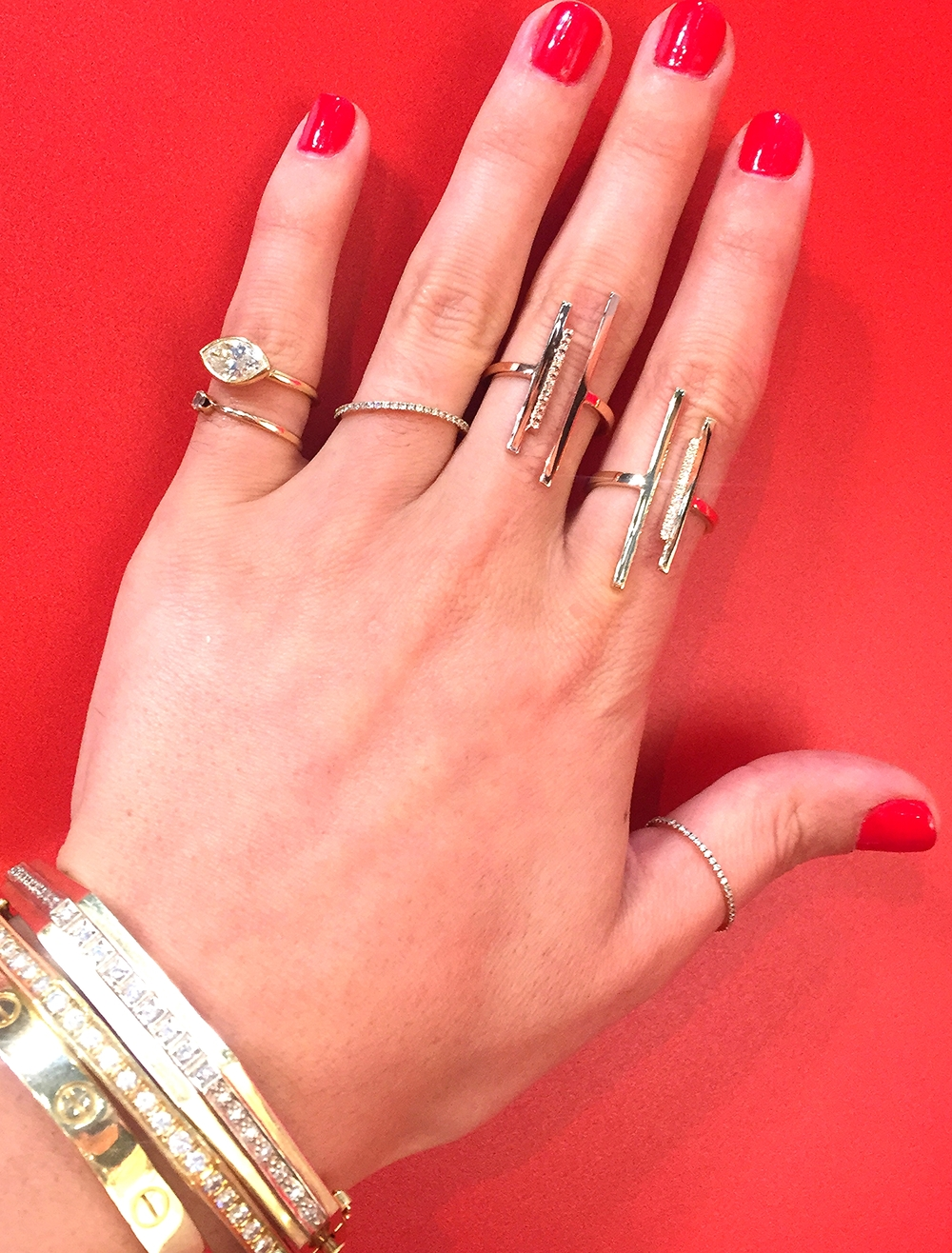 Pointer and middle finger gold and diamond open bar rings by Lauren Chisholm.