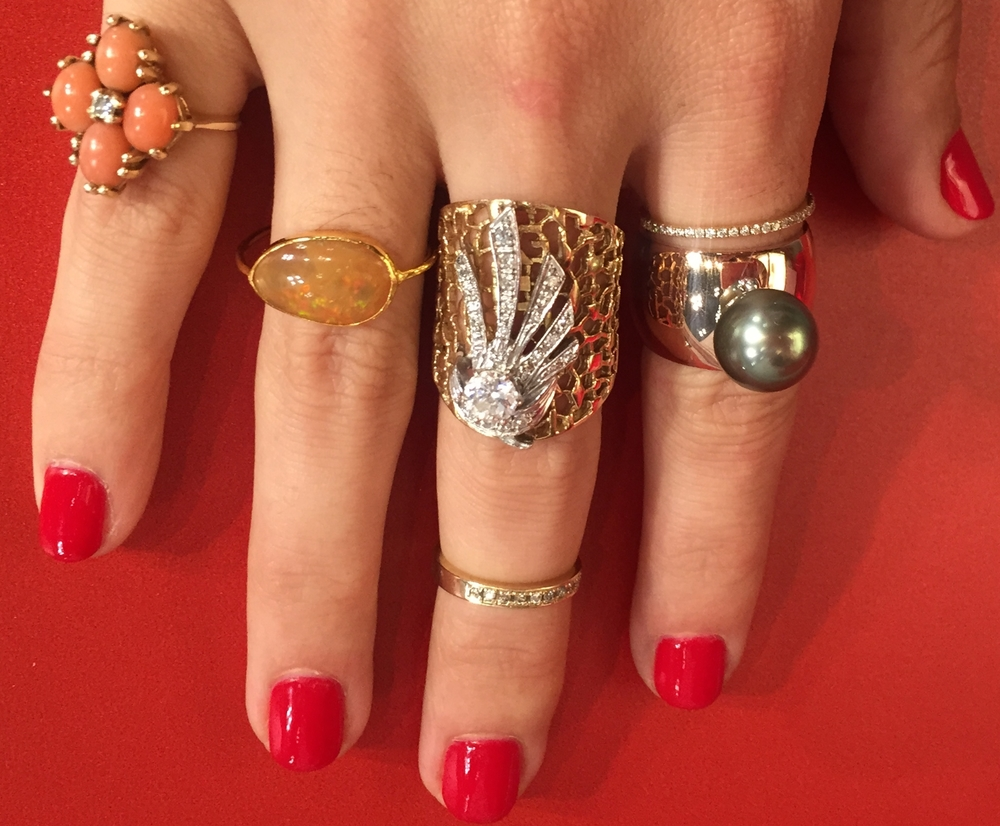 Lauren Chisholm's pearl and gold cigar band on pointer finger, stacked with FFR vintage.