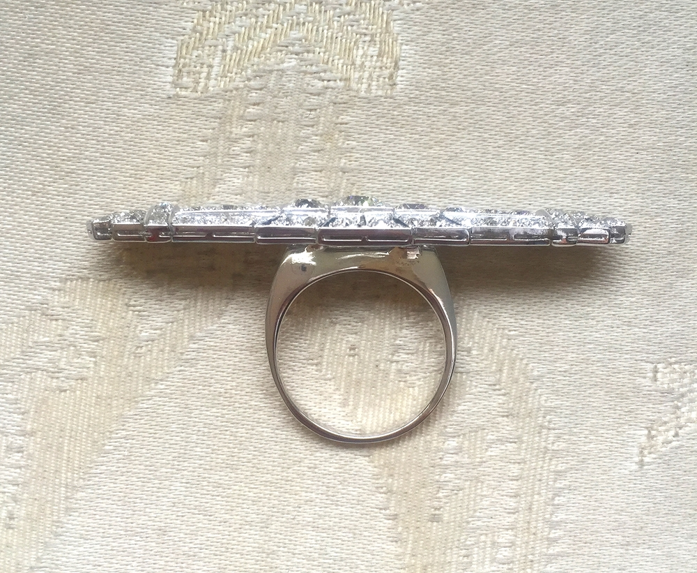 The shank on this particular ring was made for it to sit east/west across the hand.